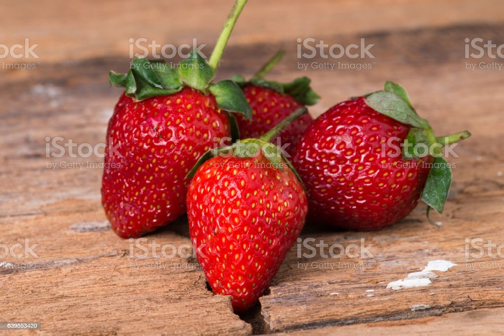 Strawberry on wooden background close up stock photo