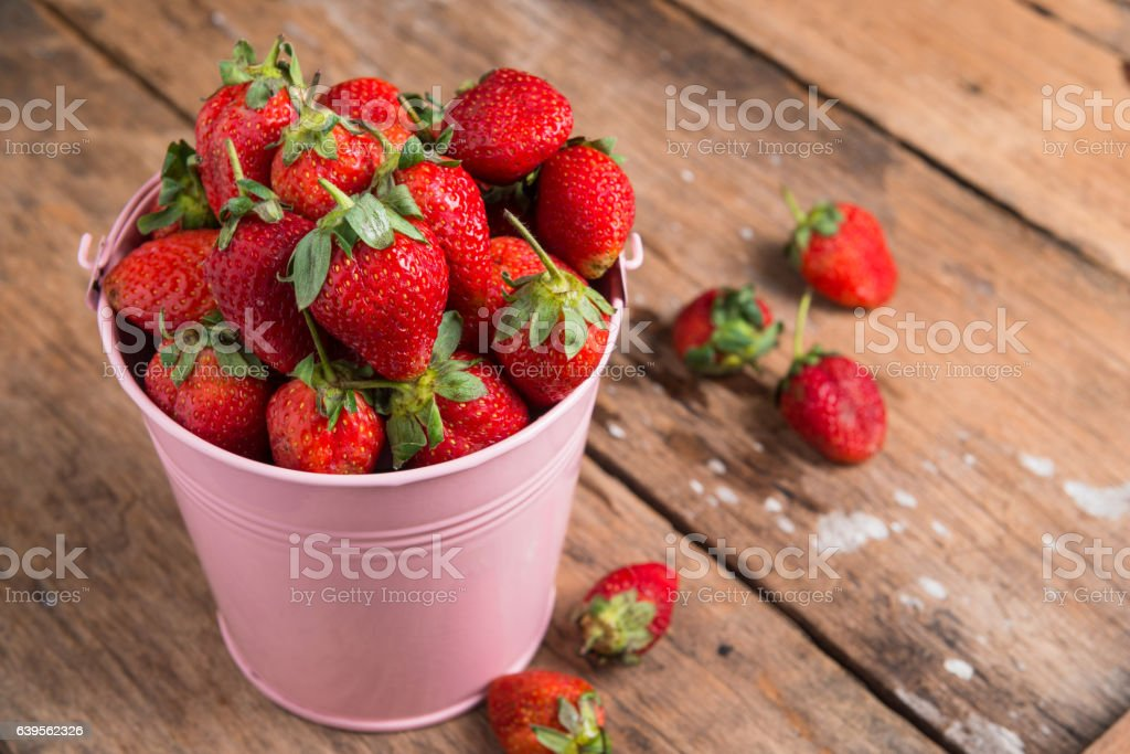 Strawberry on wooden background stock photo