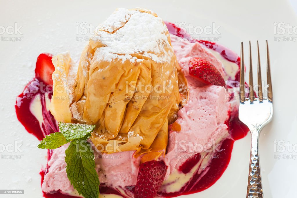 strawberry phyllo crisp with strawberry mousse and berries stock photo