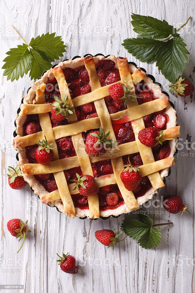 Strawberry pie with fresh berries vertical top view stock photo