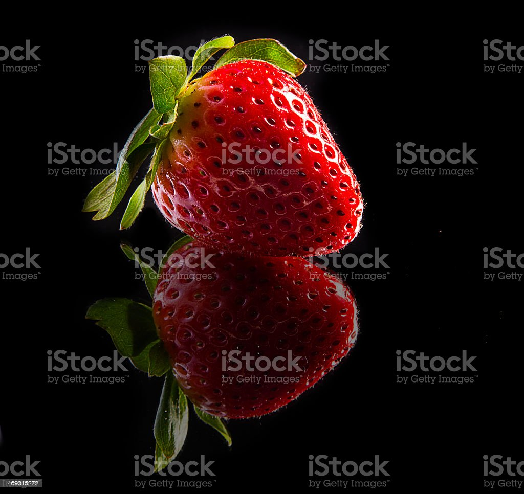 Strawberry Reflected on Black stock photo
