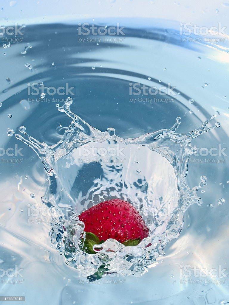 Strawberry splashing royalty-free stock photo