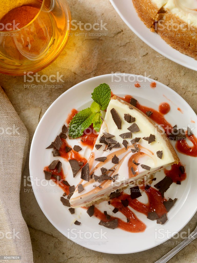 Strawberry Swirl Cheesecake with Chocolate Shavings stock photo
