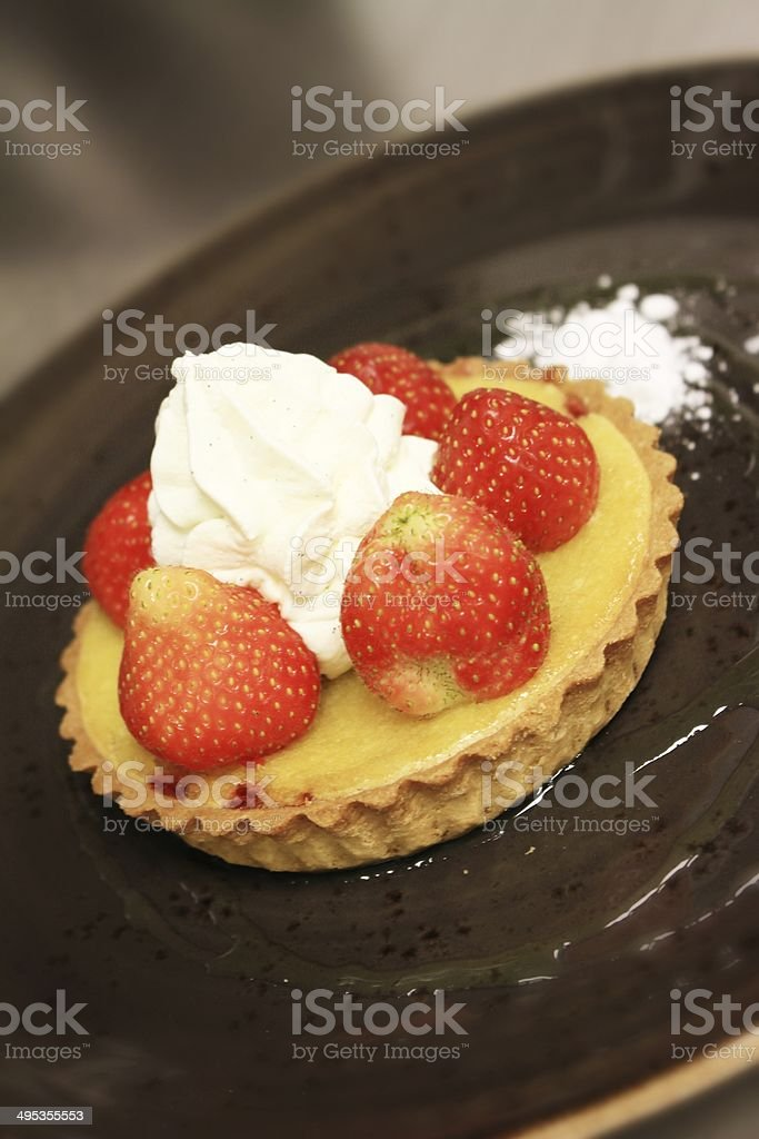 strawberry tart on slate platter stock photo