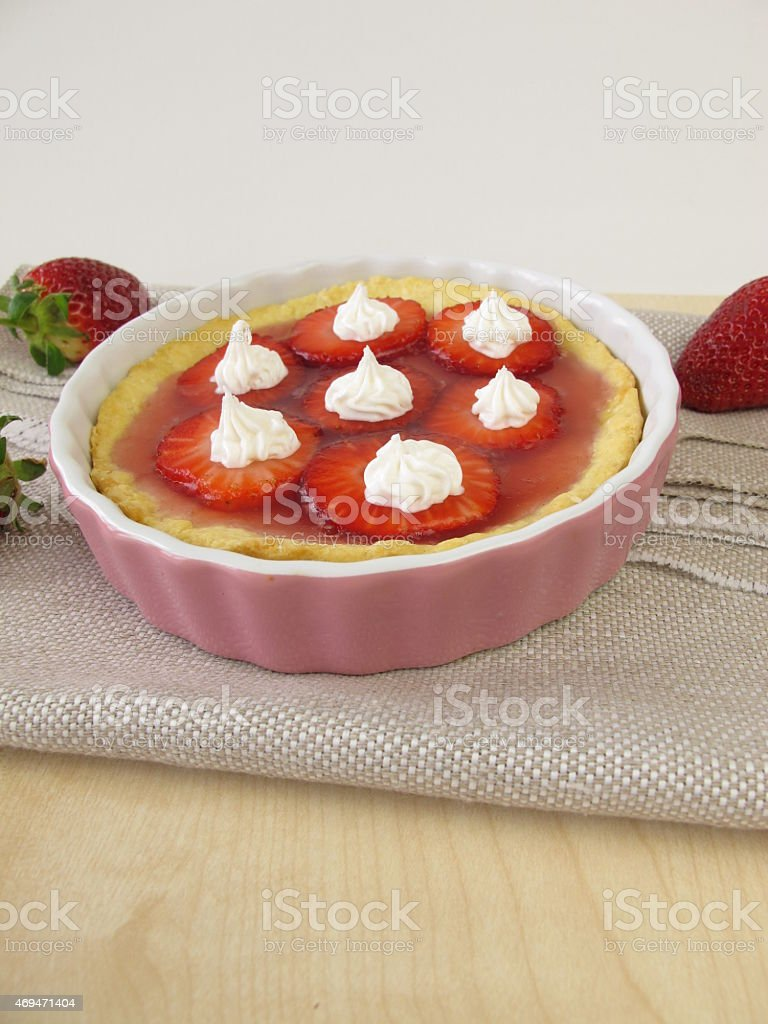 Strawberry tartlet topped with cream icing stock photo