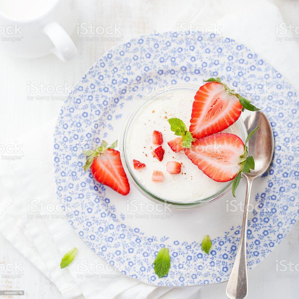 Strawberry tiramisu, trifle, custard dessert with mint leaves stock photo