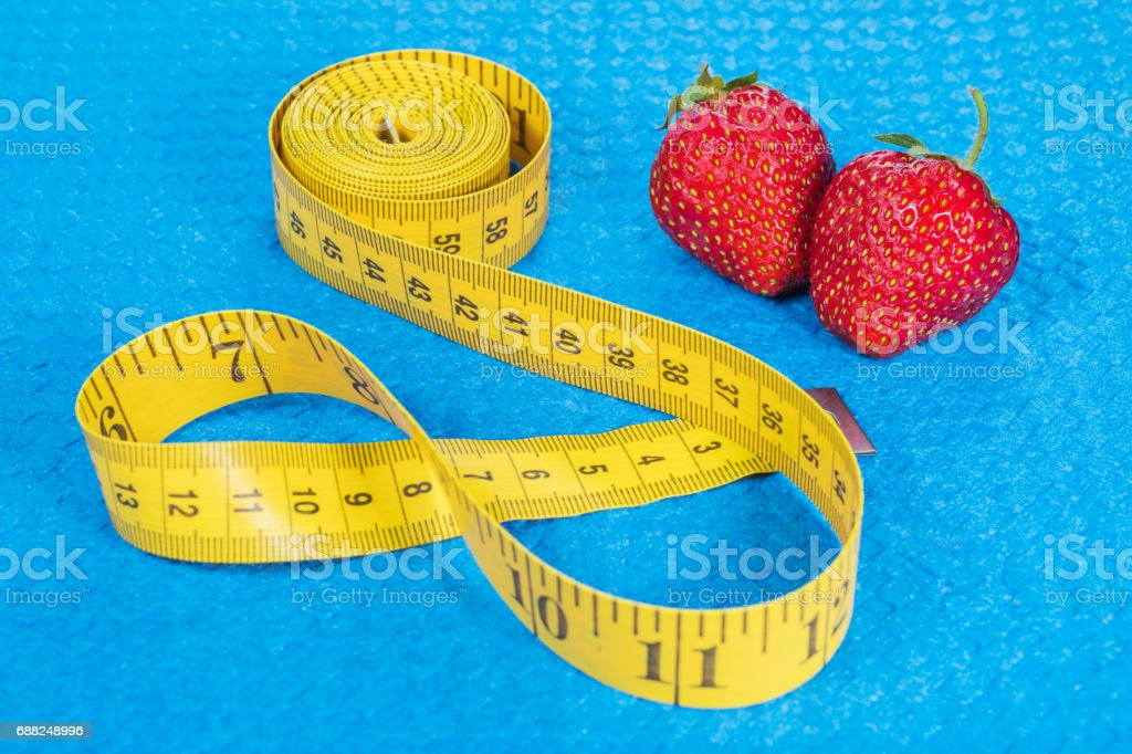 Strawberry with metric tape measure stock photo