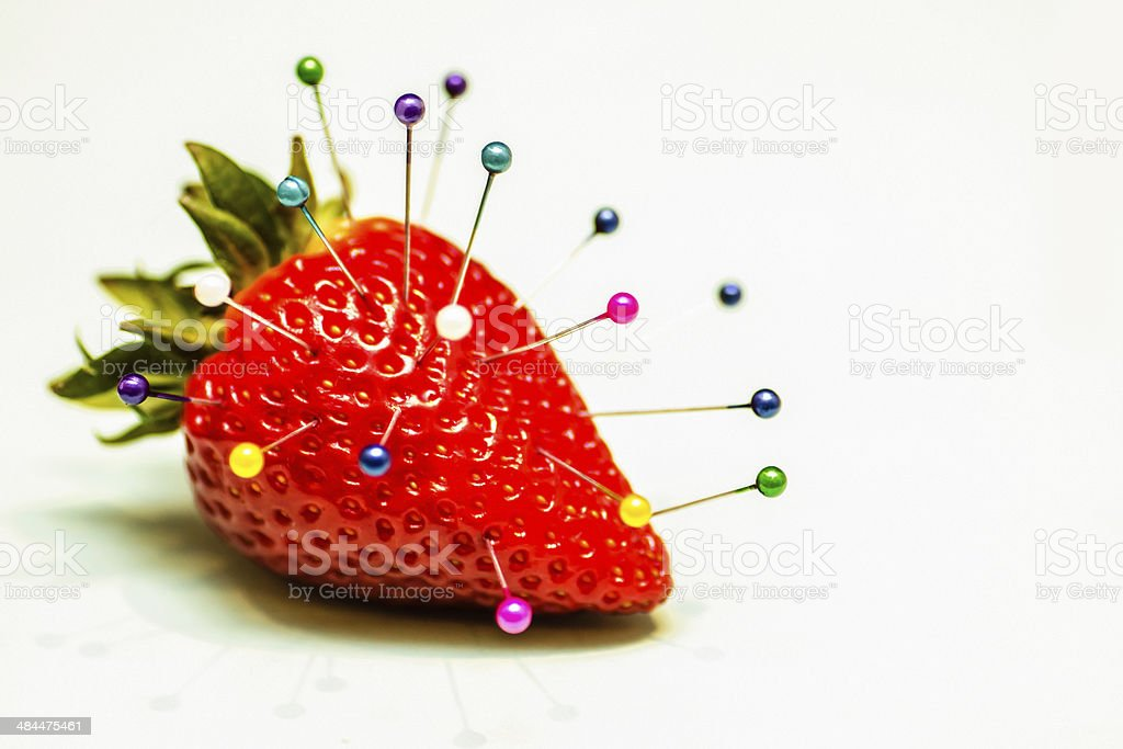 Strawberry with Pins stock photo