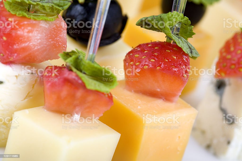 Strawberry with spearmint on various cheese royalty-free stock photo