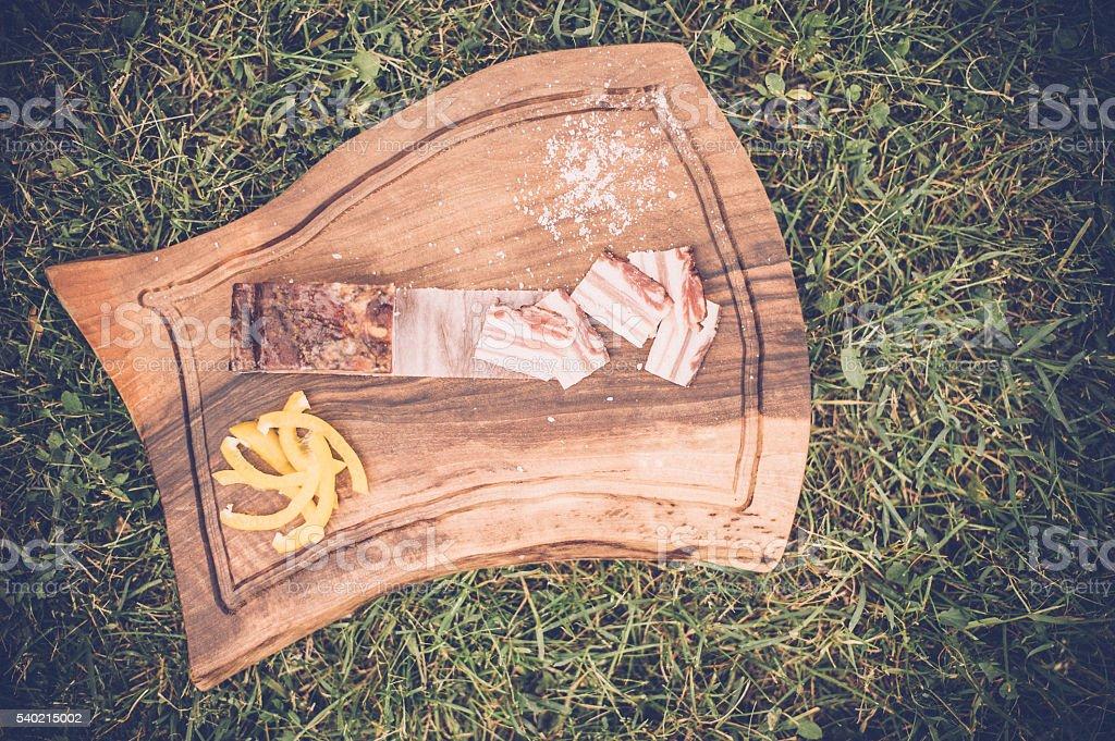 streaky bacon and fresh herbs on a wooden tray stock photo