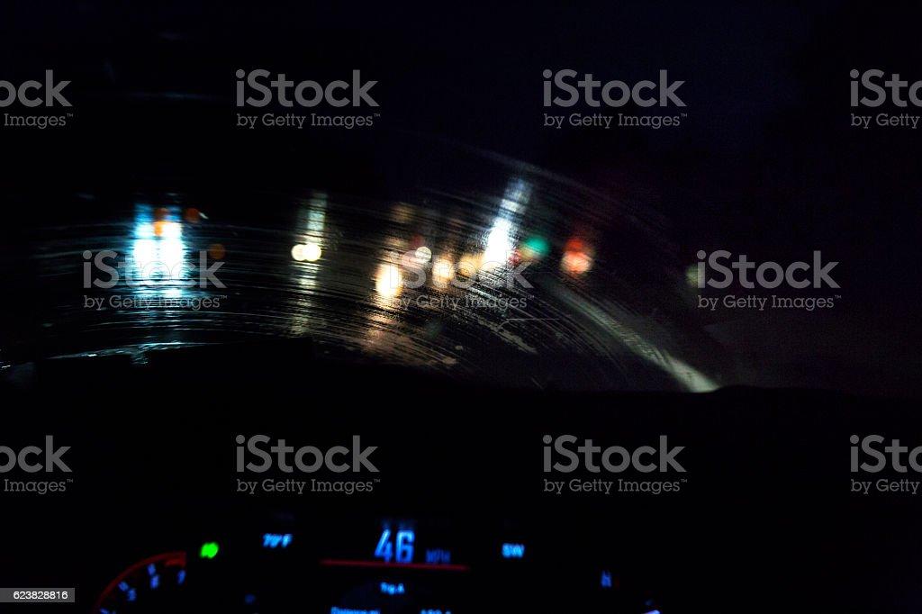 Streaky Rain Car Windshield Abstract Night Vehicle Lights stock photo