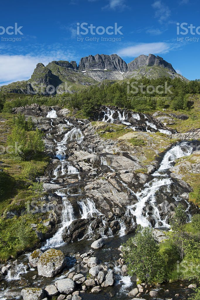 Stream and Mountain Peak in Lofted Islands, Moskenesøya, Norway stock photo