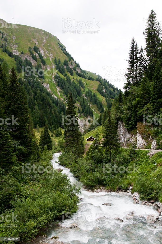 Stream in Austrian alps landscape stock photo