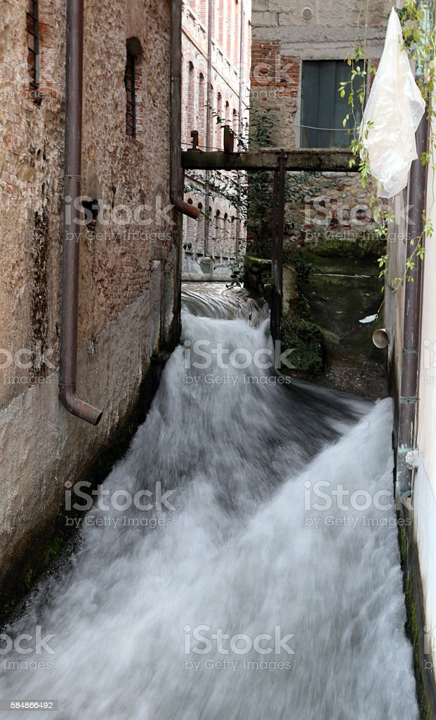 stream in the middle of the industrial building stock photo
