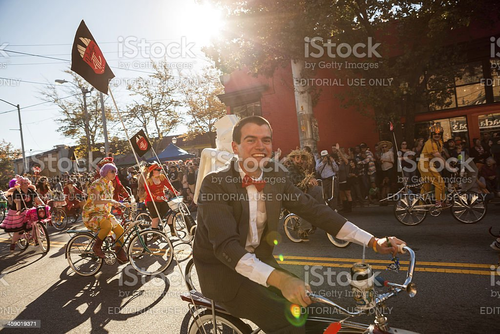 stream of bicycles at the parade stock photo