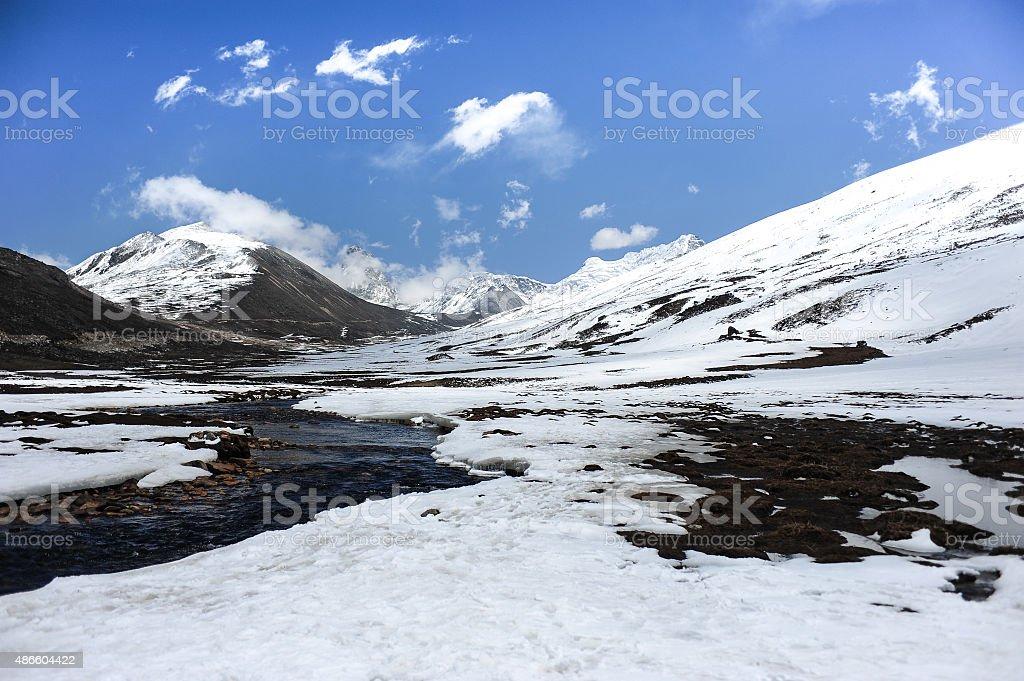 Stream of melting snow stock photo