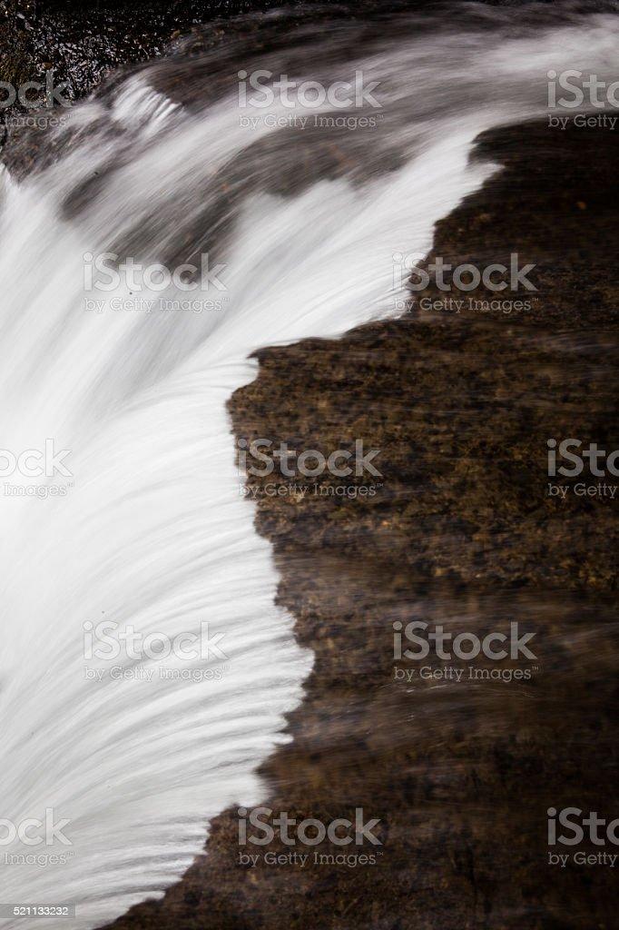 Stream rushing over rocks near Columbia Gorge in Oregon stock photo