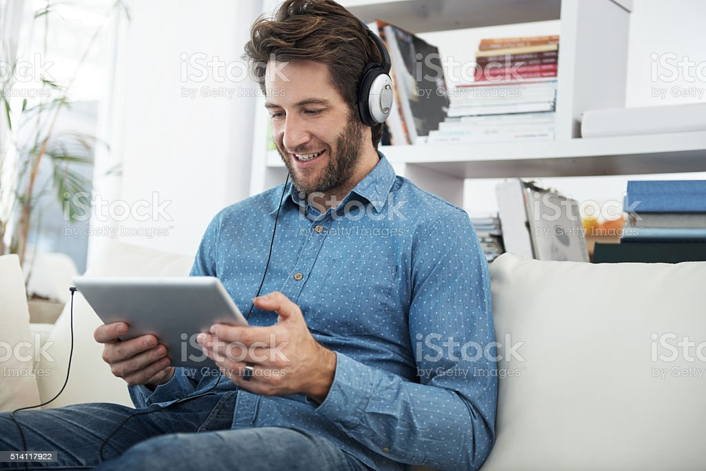 Streaming his favorite shows stock photo