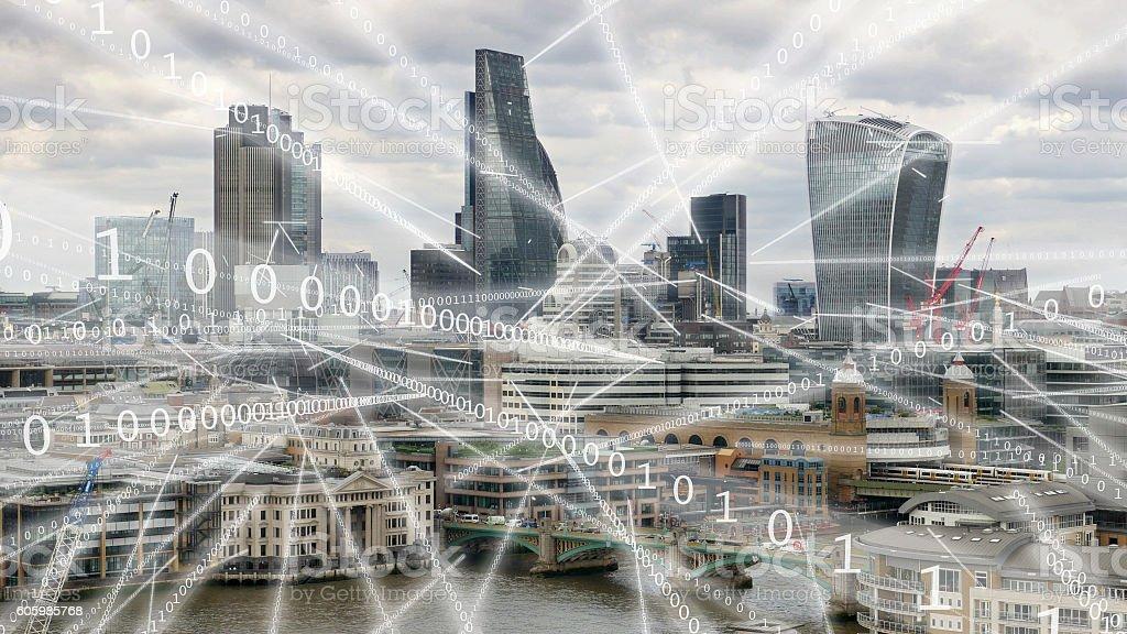 Streams of binary data flying round London. stock photo