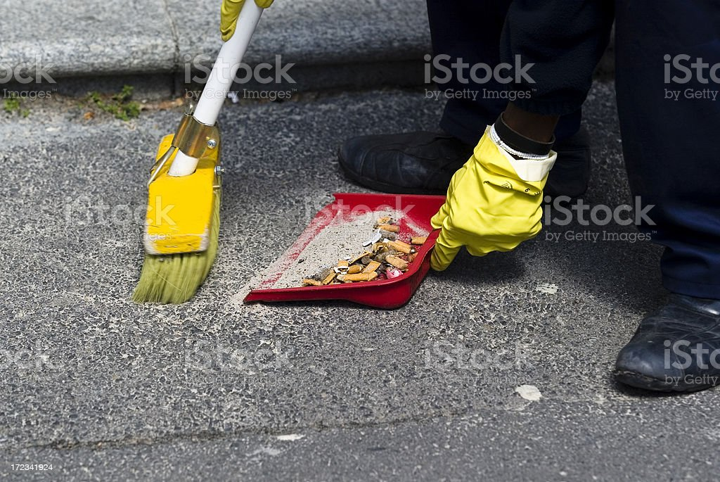 Streat cleaner with broom and dustpan stock photo