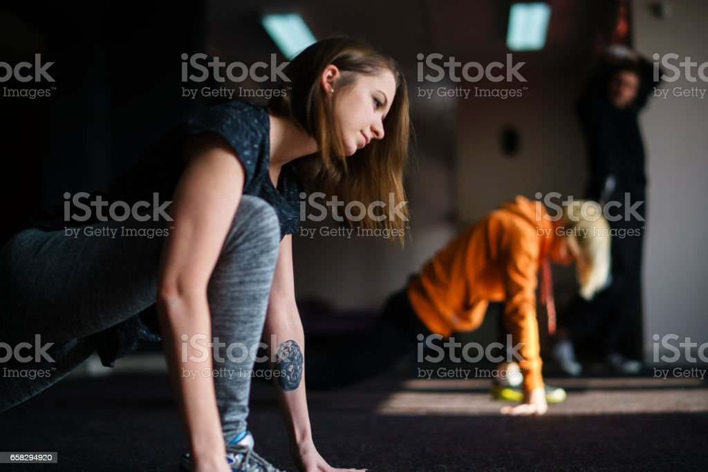Streatching before the trainee - gymnastic, fitness exercise. stock photo