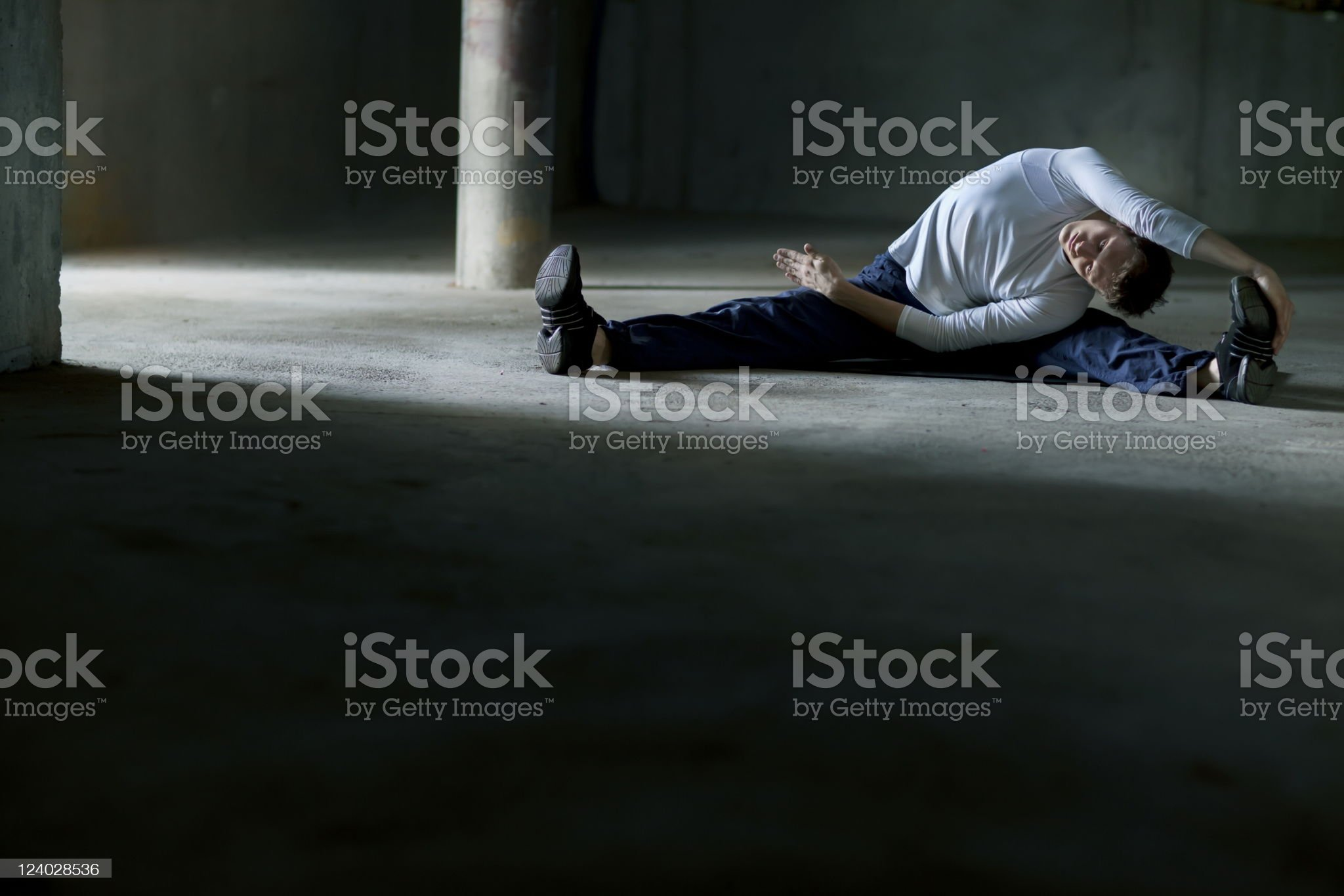 streching man on parking lot royalty-free stock photo