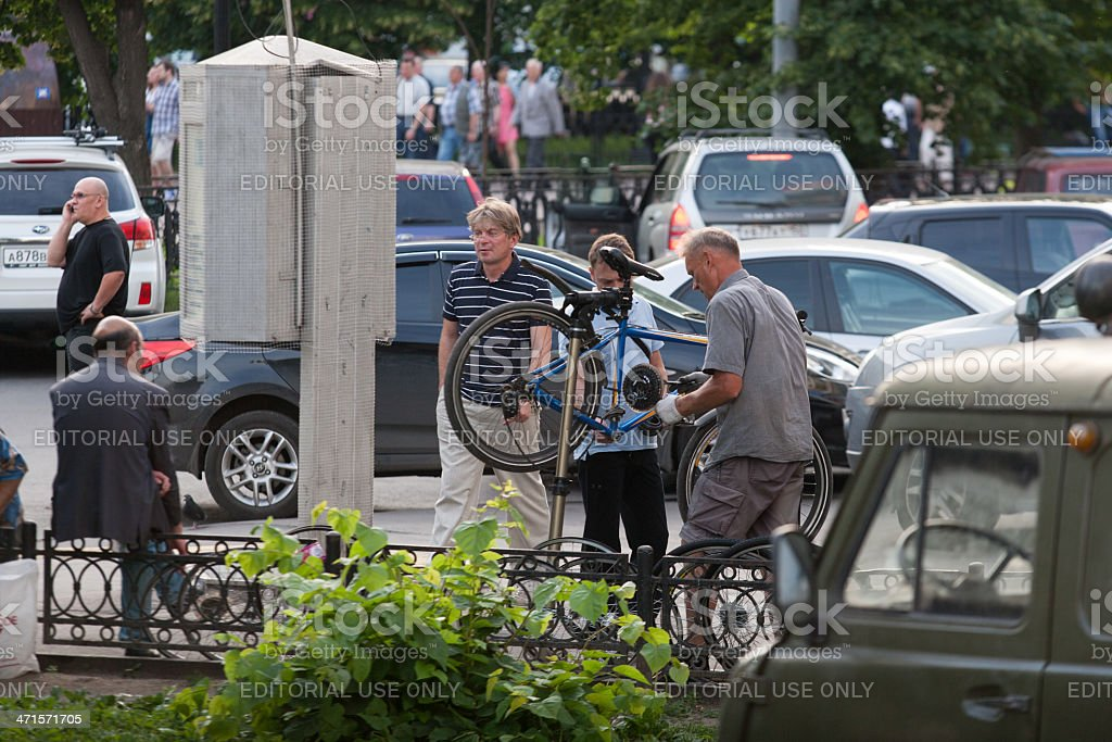 Stree mechanic repairs a bike royalty-free stock photo
