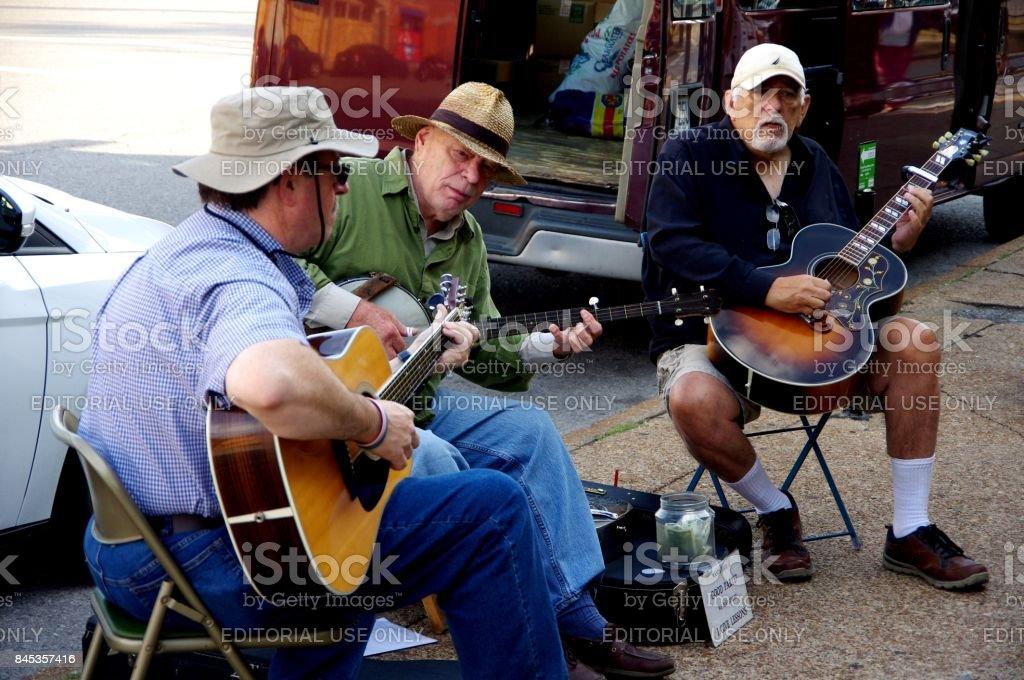Saint Louis, Missouri--September 9 bluegrass trio plays on sidewalk...