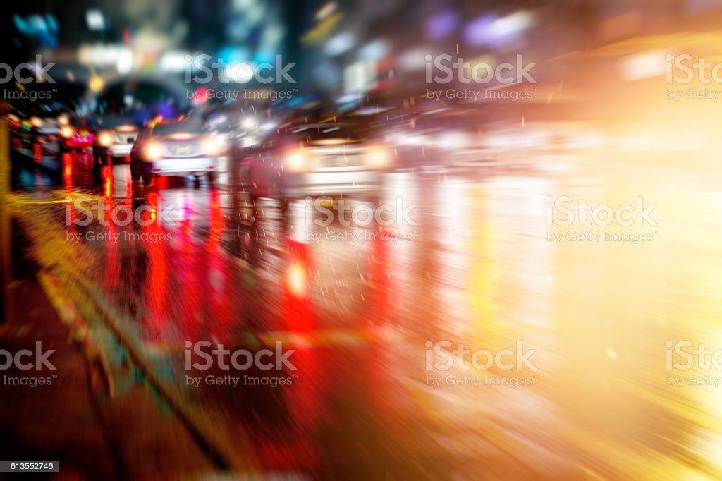 street after the rain and traffic car at night stock photo