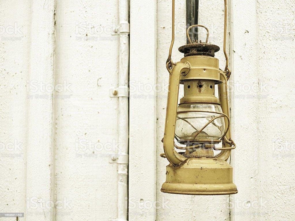 Street aged vintage kerosene oil lamp outdoor stock photo