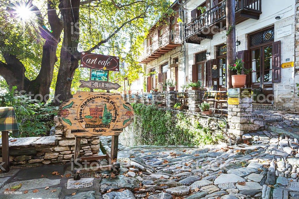 Street and cafe view at Makrinitsa village of Pelion, Greece stock photo