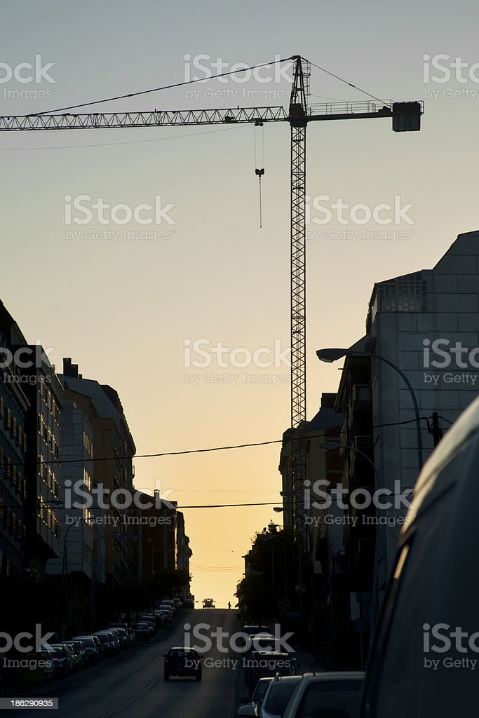 Street and crane at dusk. royalty-free stock photo