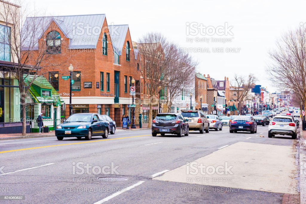 Street and shops in Georgetown neighborhood with traffic stock photo