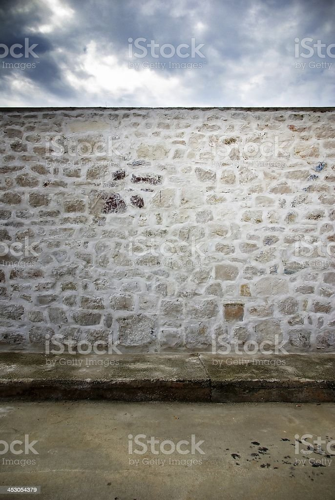 Street and stone wall texture background royalty-free stock photo