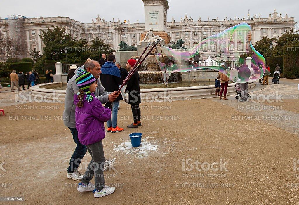 Street animator demonstrating huge soap bubbles stock photo