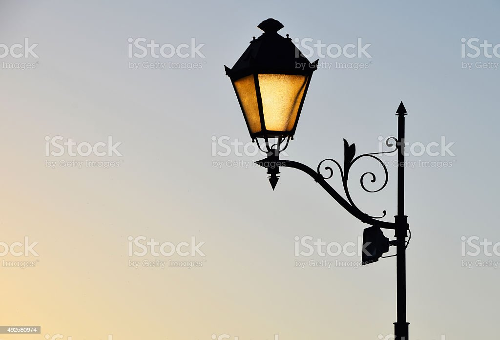 Street antique style lamp post with effect of shine royalty-free stock photo