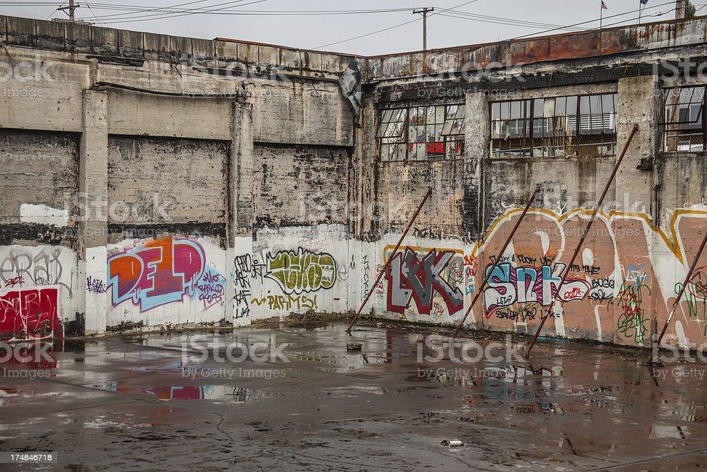 Street Art on Wall Graffiti in Broken down building royalty-free stock photo