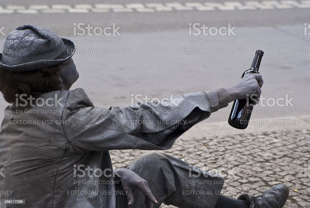 street artist acts like a grey drunk character stock photo