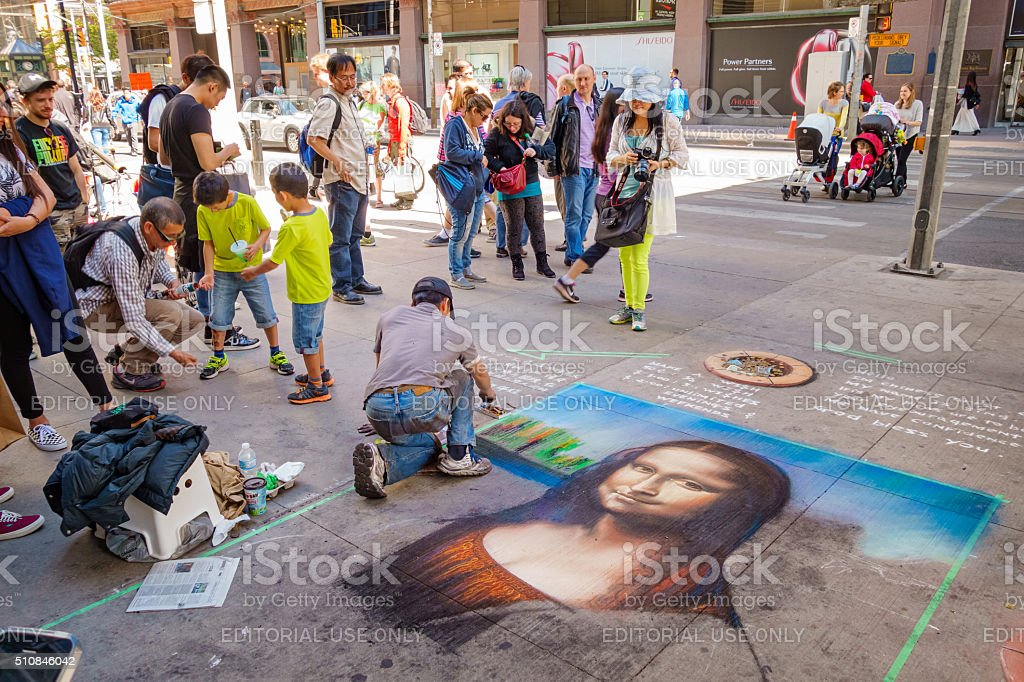Street Artist Drawing for Donations stock photo