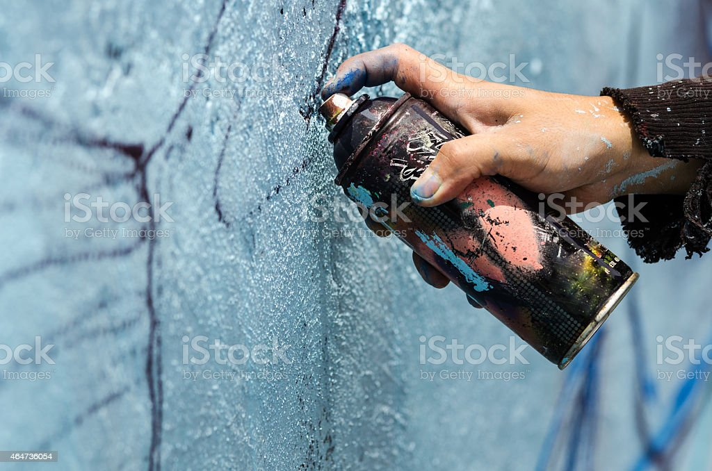 Street artist draws with spray paint can stock photo