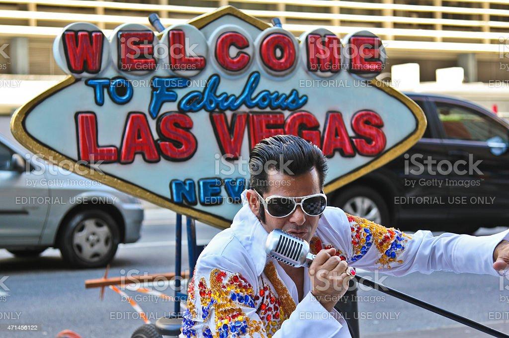Street artist imitates Elvis Presley stock photo