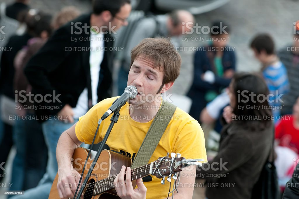 Street artist playing guitar in paris royalty-free stock photo