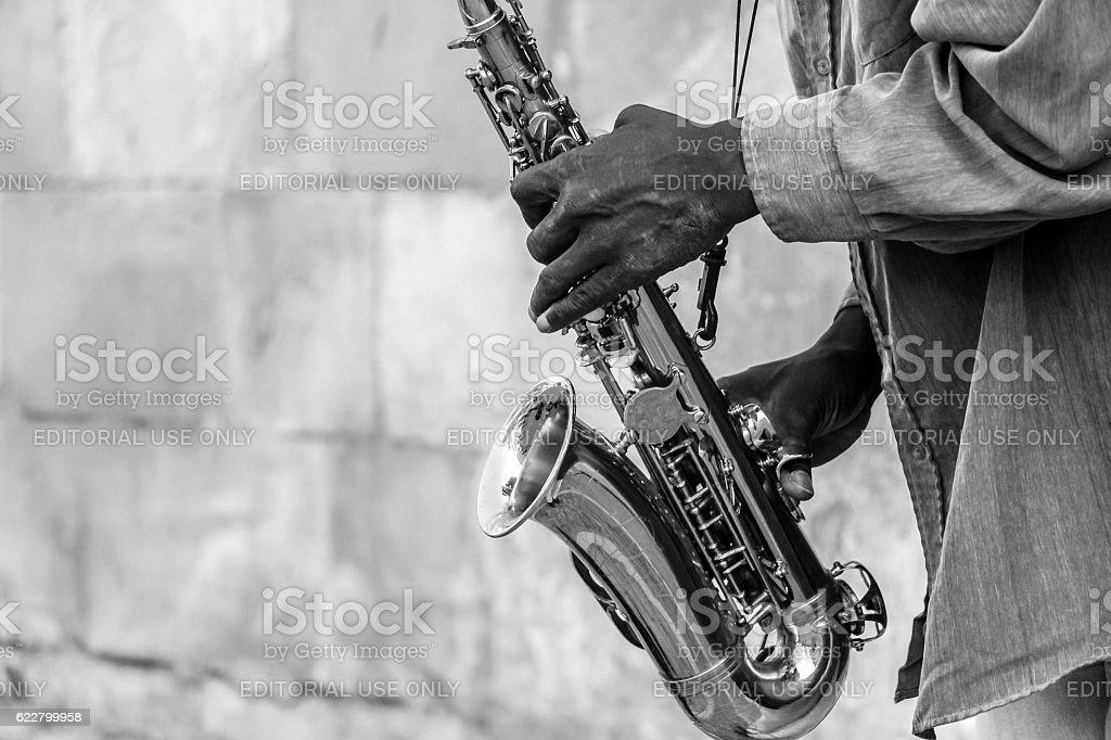 street artist playing Saxophone stock photo