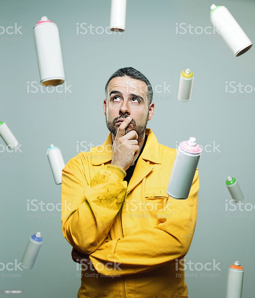 Street artist with floating cans stock photo