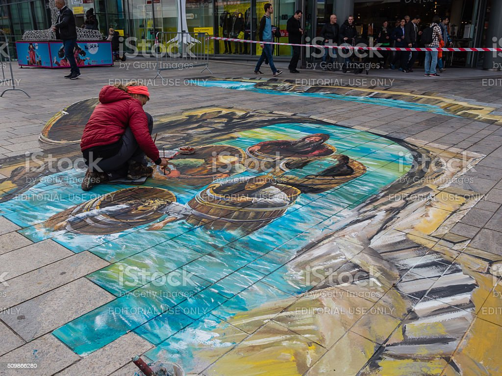 Street artist working a 3D painting stock photo