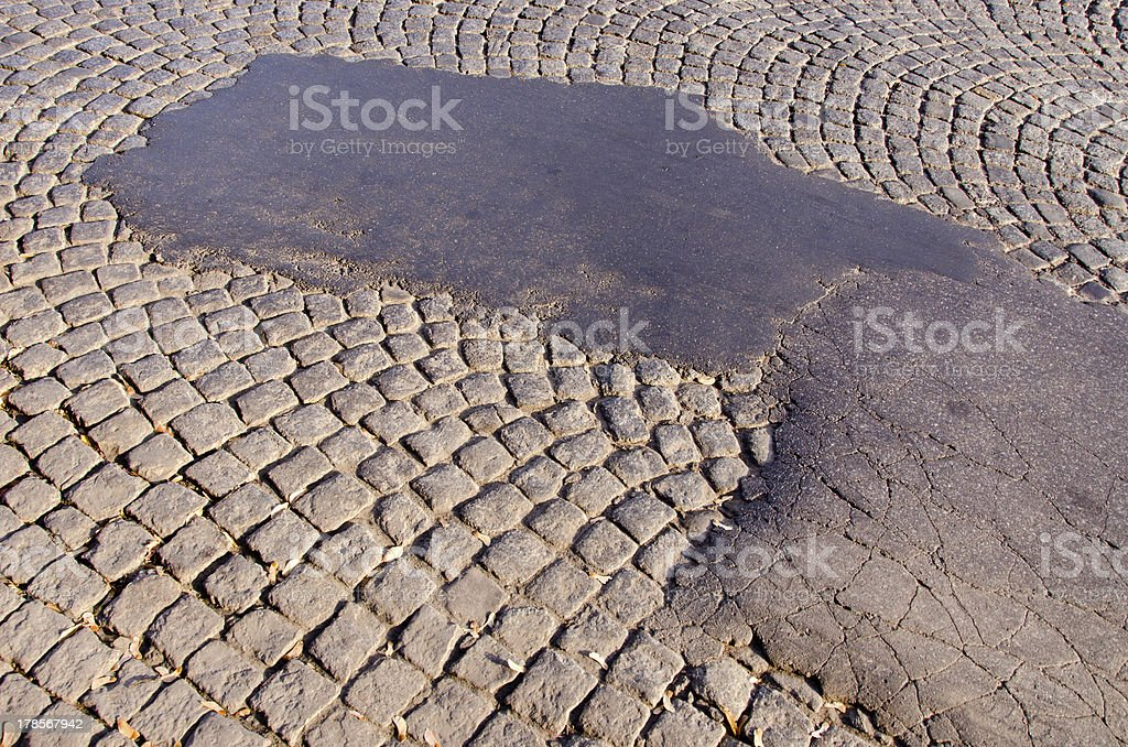 street asphalt and stone bricks background stock photo