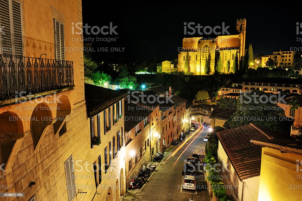 Street at night in Siena, Italy stock photo