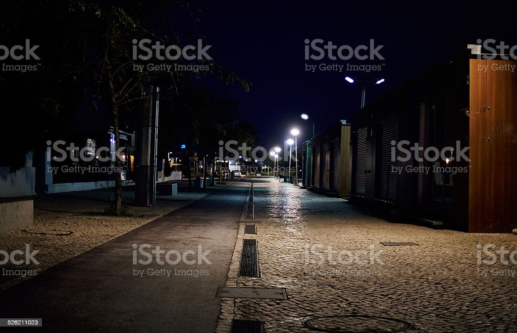 Street at night in the town with light and trees stock photo