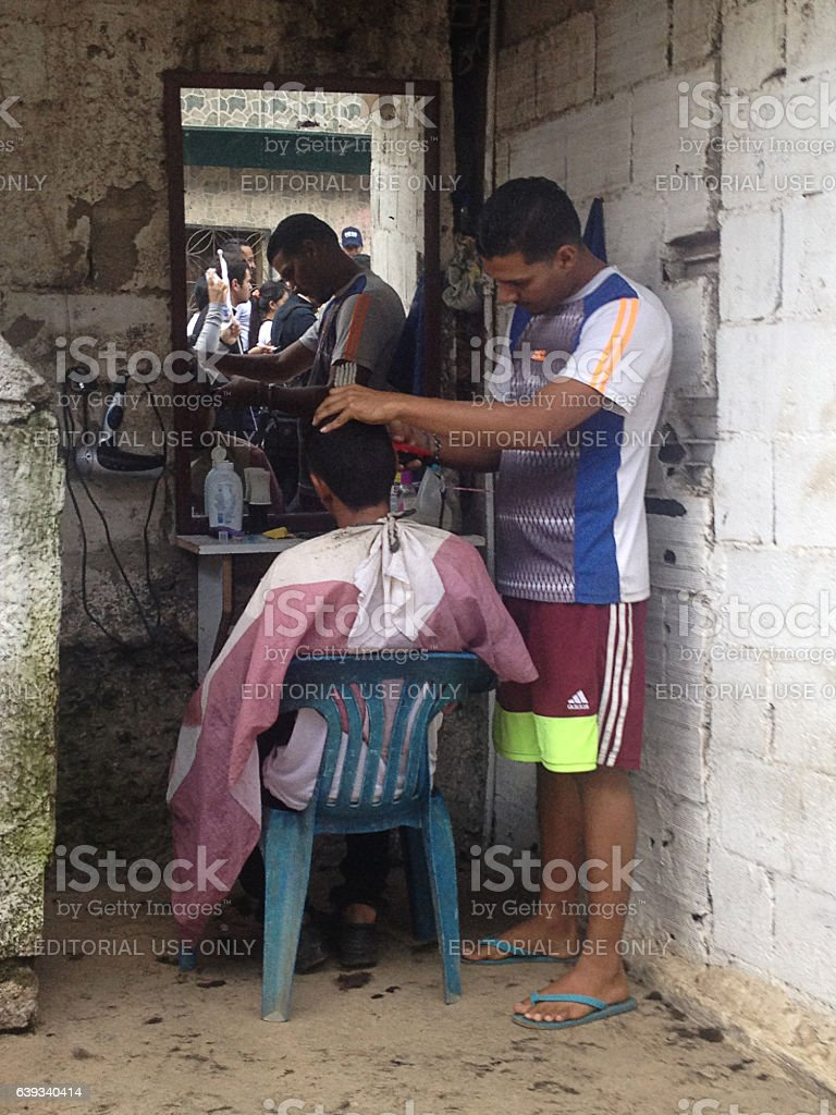 Street barber cutting a clients hair stock photo