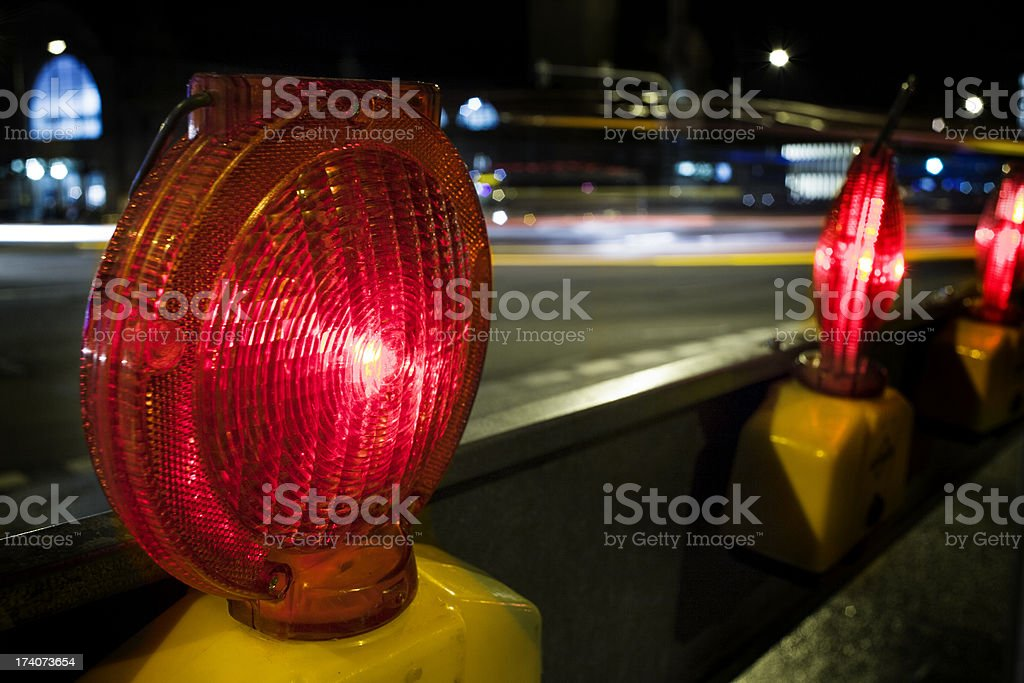 Street barricades light at night - traffic in the background stock photo